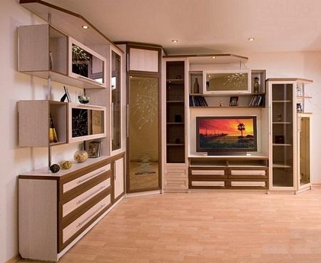 Преимущества угловых стенок в гостиную: советы по выбору